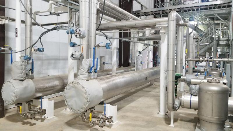 Process area skids, custom designed hot water systems